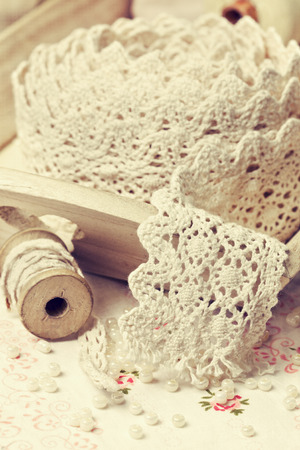 old spools: lace ribbon, old spools of thread in vintage style