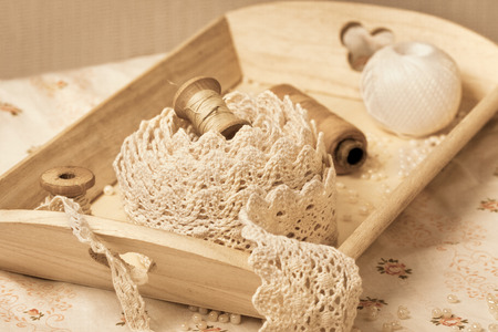 old spools: lace, old spools of thread in vintage style