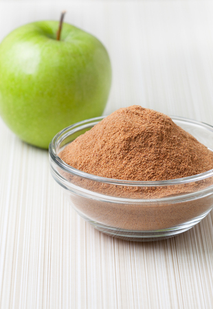 cellulose: crushed apple fiber, green apple on a light  background. dietary product Foto de archivo