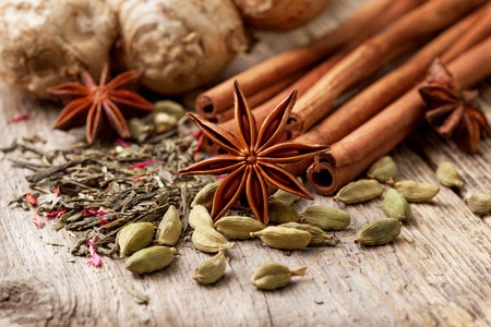 ingredients for making tea with spices on the old wooden background