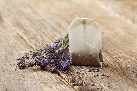 teabag with lavender on the old wooden background Stock Photo
