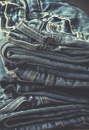 stack of jeans in vintage style. toning Stock Photo