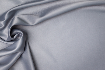 Drape gray satin fabric closeup.
