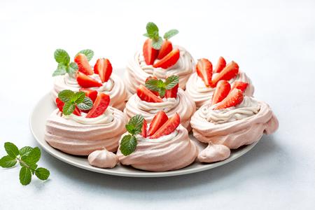 Pavlova chocolate mini cakes with strawberries close-up