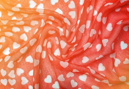 Drapery red fabric with white hearts close-up