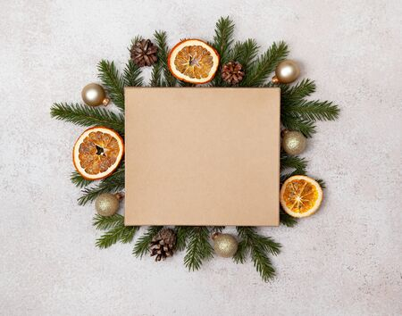 Christmas holiday composition. gift box with christmas tree branches, festive baubles on a light background. Flat lay, top view, copy space, mockup.