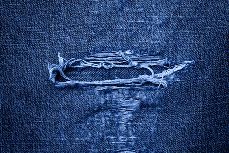 Classic Blue abstract background. Color of the year 2020. background of old worn jeans
