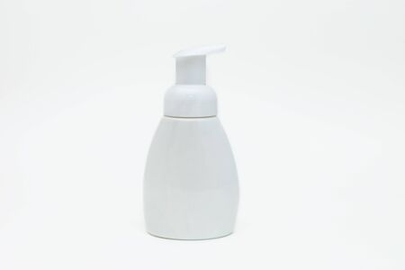 White bottle of liquid soap on a white background