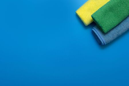 Three Colorful, dry microfiber cloths for different surfaces cleaning in kitchen, bathroom and other rooms. Banco de Imagens