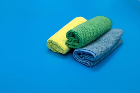 Colorful, dry microfiber cloths for different surfaces cleaning in kitchen, bathroom and other rooms. Banco de Imagens