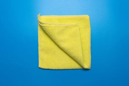 yellow microfiber cloth for different surfaces cleaning in kitchen, bathroom and other rooms.