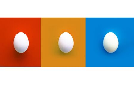 Collage of red, orange and blue rectangles with three white chicken eggs. white background. Copy space. Top view Banco de Imagens