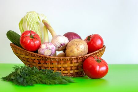 The wicker basket is on the table with Vegetarian Vegetables Health Food on the green table