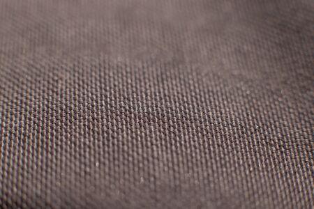 Closeup detail of brown fabric texture background. Selectiv focus. Copy space. Macro