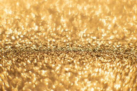 Golden sand abstract bokeh lights. defocused background