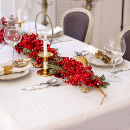 Close up Christmas and New Year table setting in natural and white and red colors Stock fotó