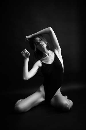 actress of plastic theater expresses emotions through facial expressions of the body and face, black and white fashion photo of person