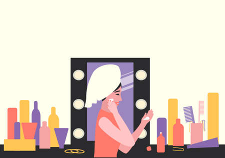 A woman takes care of her skin by applying cream to her face. Daily procedure in front of the dressing table. Close-up of a woman and her makeup. Flat vector illustration.