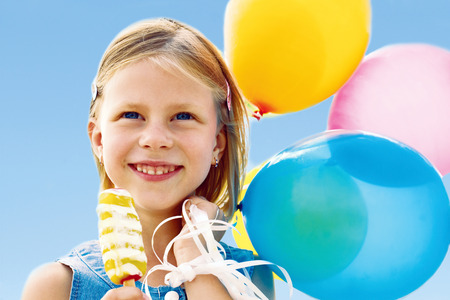 Child playing with balloons photo
