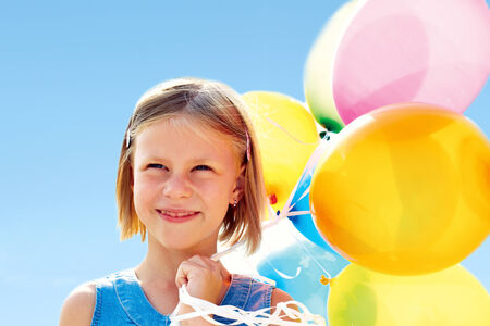 smiling little girl with colorful balloons photo