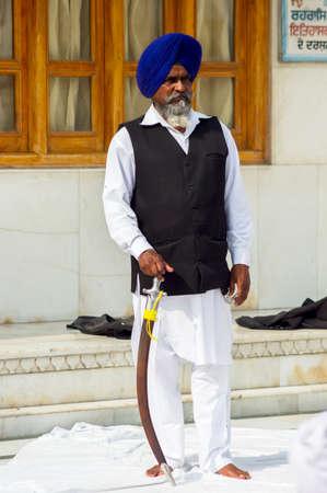 Amritsar, India - November 21, 2011: Sikh musicians at the Golden Temple complex, Amritsar, Punjab, India. Редакционное