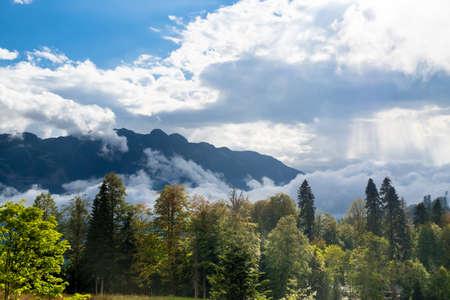Mountain landscape with cloudy sky, krasnaya polyana, sochi, russia.