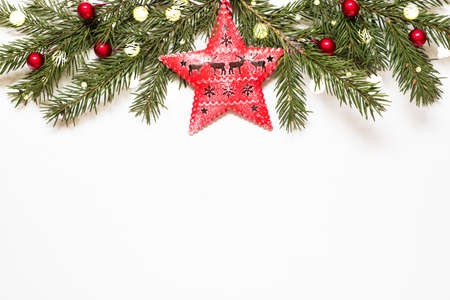 Composition with christmas tree branches, star and christmas lights on white background. Archivio Fotografico