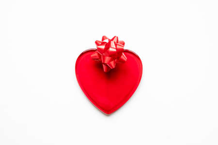 Valentine's day, love, romantic concept. Red heart and bow on a white background Stock fotó