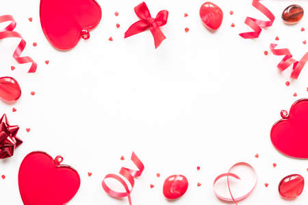 Valentine's day, love, romantic concept. Red hearts and ribbon on a white background with copy space Stock fotó