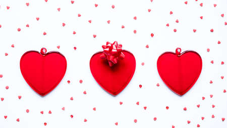Valentine's day, love, romantic concept. Red hearts and bow on a white background Stock fotó