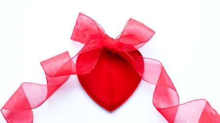 Valentine's day, love, romantic concept. Red heart, bow and ribbon on a white background