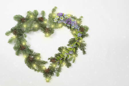 Christmas wreath in heart shape with flowers