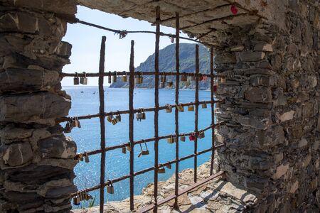 Lot of locks on iron lattice, sea