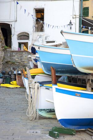 Old boats on a shore, building, background Banque d'images - 131595320