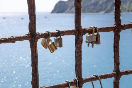 A lot of lock, like symbol of love on an iron lattice on seashore