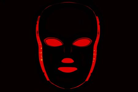 Led mask glowing red on black background Stok Fotoğraf