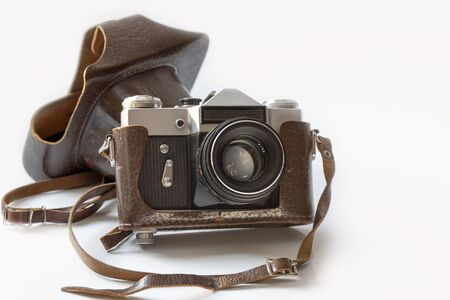 Vintage photo camera with leather brown case, isolated on white backbackground