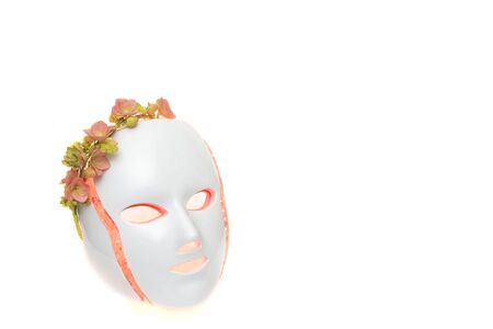 Color therapy mask glowing red with flower crown