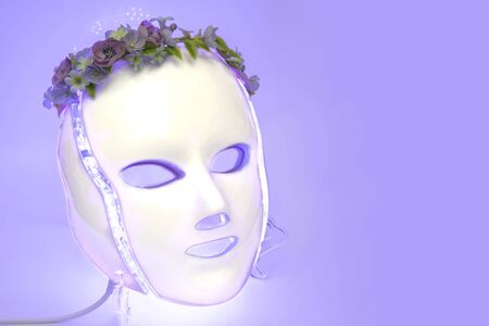 Color therapy mask glowing light purple, flowers