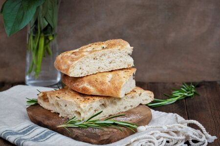 Sliced focaccia sour dough bread, dark background