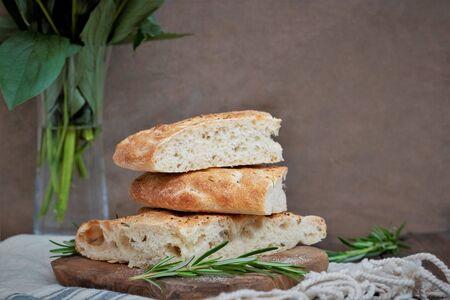 Sliced focaccia sour dough bread, dark background