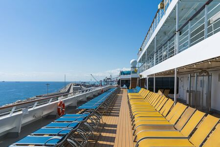 Sunbeds on a deck of a cruise ship 写真素材
