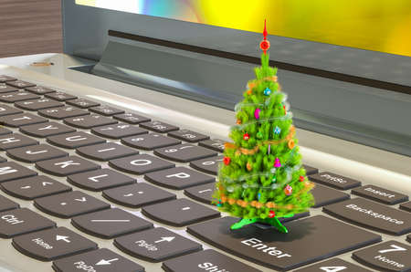 Christmas tree on the keyboard of laptop, 3D rendering isolated on white background