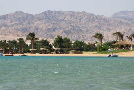 dahab: Rest in Egypt, the red sea, waves, a beach. Beach rest. Egypt, Dahab, Sinai Peninsula.