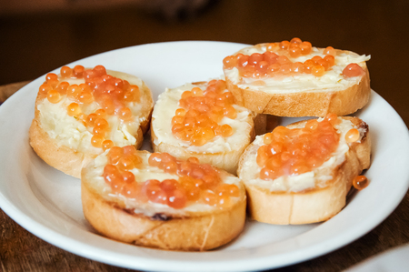 sandwiches with red caviar on a plate Stock Photo