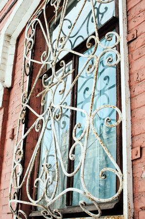 metal grate: Window with iron bars