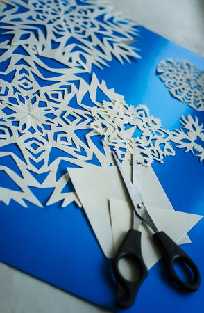 Christmas snowflakes cut from paper