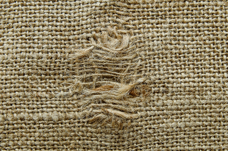 worn structure: burlap texture with a hole Stock Photo