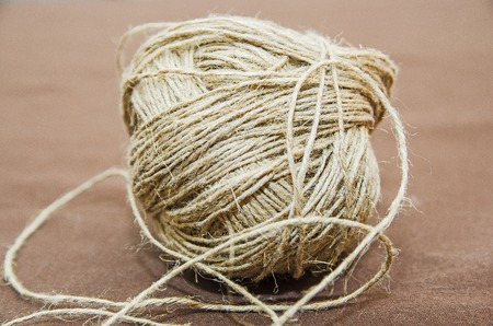 Skein of twine, rope on a beige background. Flat Lay