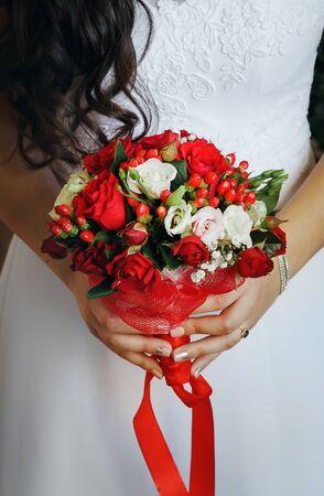 wedding bouquet in brides hands